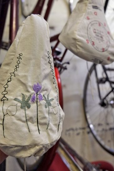 Hand embroidered seat cover at Broken Spoke